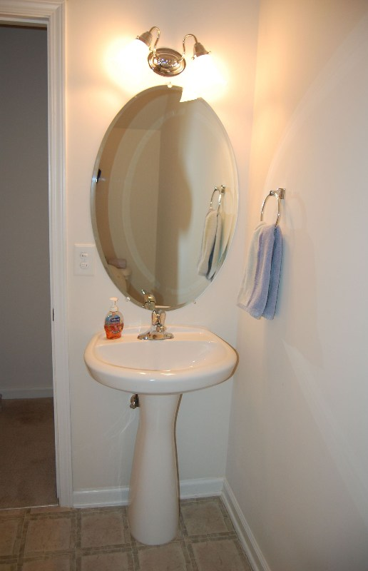Delicieux ... Pedestal Sink Oval Mirror Above Double Light Fixture And. Listings  1992494 B